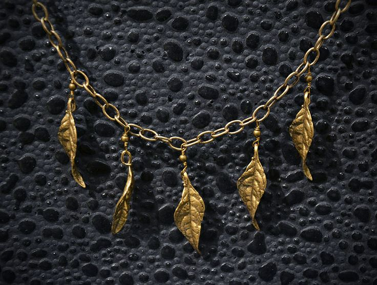 Smitten Designs necklace with brass twisted leaves on a sleek brass link chain. Available at Fine Finds Boutique in Vancouver.
