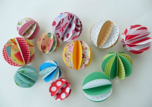 Paper balls - great for making a swag or wired together to make a wreath, or hung in strings to make a curtain.