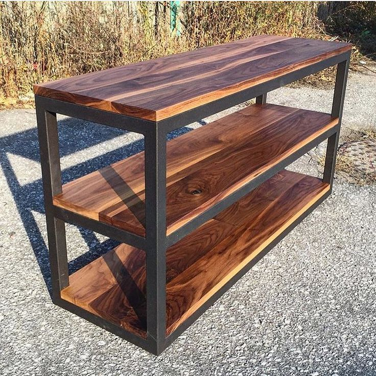 """""""Custom built store fixture. This piece is a welded, powder coated frame featuring 3 walnut shelves perfect for displaying product. #StoreFixture…"""""""