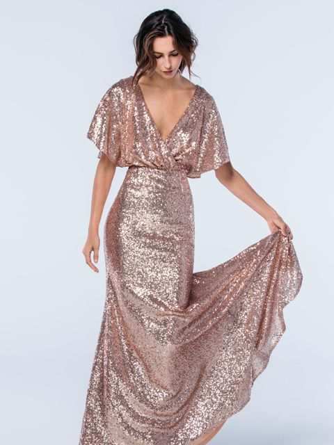 This striking sparkly open back dress from the Watters Bridesmaids collection has been beautifully designed using Eclat sequin fabric and features dolman sleeves and a draped v-neckline. Product name Elson 2306 in Rosegold.  View more Bridesmaid dresses from our Watters collection at: http://www.baroqueboutique.co.uk/bridesmaids/  Photographs courtesy of: https://www.watters.com/watters/bridesmaids/