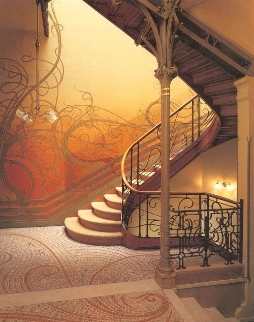 Interior decor of the 1920's - glorious wrought iron staircase, with echoes of the design on the glowing amber walls. Suberb!