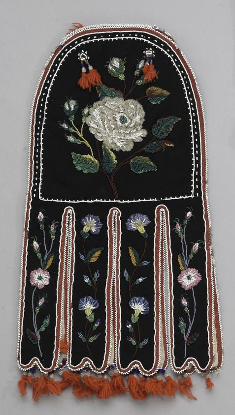 A Red River Metis beaded octopus bag  On black felt trimmed with red silk, partially beaded in heavy three-dimensional renditions of naturalistic floriforms, wool tassel suspensions.  length 20in