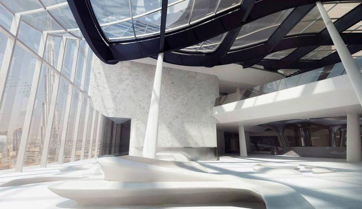 vertical cafe rises through opus dubai hotel by zaha hadid