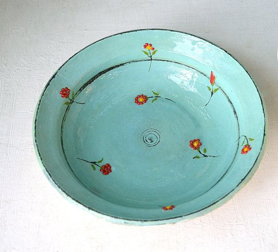 turquoise bowl with red flowers, by Kelim Pottery