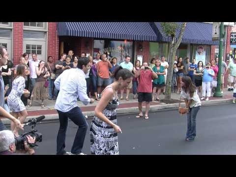 Awww! We can't help but smile when a guy literally dances in the street to propose to his girlfriend #flashmob