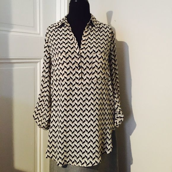 ⬇️30% off bundles Pleione Nordstrom Chevron Top! Me an offer! Nordstroms Pleione Chevron Black, tan and beige tunic/ top! Buttons down to chest. Retails $78. Dress up or down! Great used condition! Size XS but fits like a medium so I've listed as a medium. Feel free to make a reasonable offer! I'm selling to the first offer I receive! Or get 30% off with a bundle! Huge End of the Year Sale and everything must go! Pleione Tops