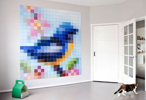 ixxi is a modular hanging system that joins cards together in a pattern to create wall art.