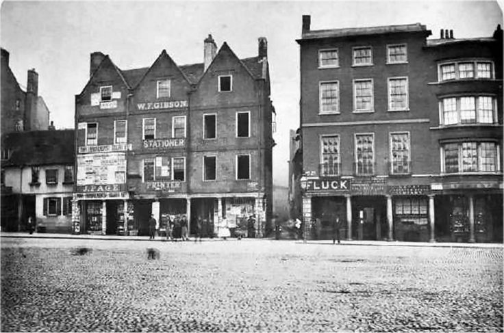 Long Row West, Nottingham, c 1865.  The corner of Long Row West and Sheep Lane, before it was widened and renamed Market Street. The Talbot Inn is on the extreme left.