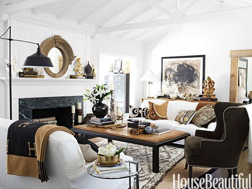 """""""Someone once said that a home is like an autobiography, and my California living room is filled with things I love — a Beni Ourain rug, Indian sculpture, a wood mirror found at a local flea market,"""" Monica Bhargava says."""