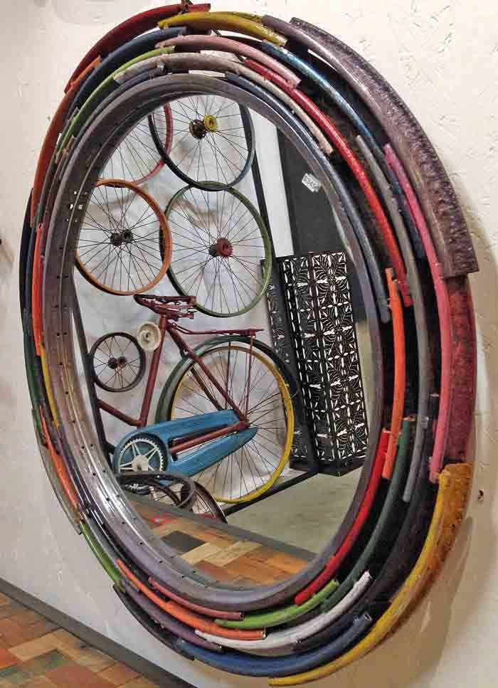 Mirror with frame hand crafted from salvaged and recycled and up cycled bicycle and bike wheel