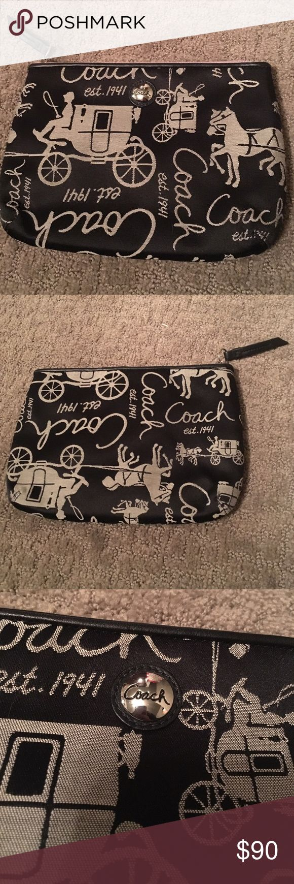 Coach clutch Gorgeous black coach clutch/makeup bag with carriages on it. It is purple on the inside and is divided into two compartments. It's NWOT, I got it as a gift and never used it. Coach Bags Clutches & Wristlets
