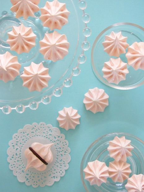 pink meringue cookies - I would probably  flavor these guys with a Peppermint flavoring or a berry flavoring like raspberry. I do like the idea of sandwiching them together with some dark chocolate ganache