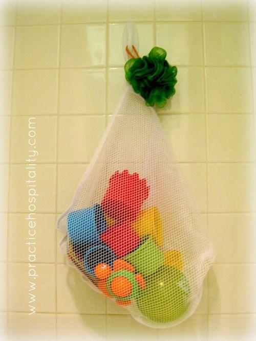 $1 Storage Solution--lingerie bag as bath toy storage...