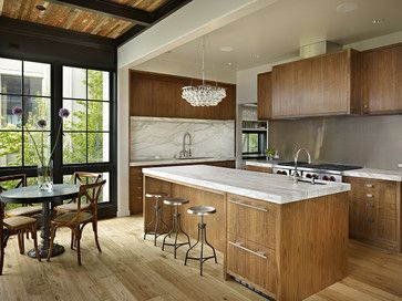 (a)American Black Walnut w/clear finish - no stain. (b)2.5in thick Calacatta marble counter; stainless steel w/satin finish backsplash; and a Ochre Arctic Pear Chandelier