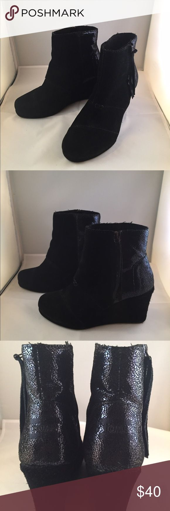TOMS Black Suede Wedge Boots Women's Size 7 TOMS Black Suede Wedge Boots Women's Size 7.  Back of the ankle has a shimmer like detail. Worn a handful of times.  Super cute, but pregnancy did a number on my feet, and now my loss is your gain! TOMS Shoes Ankle Boots & Booties