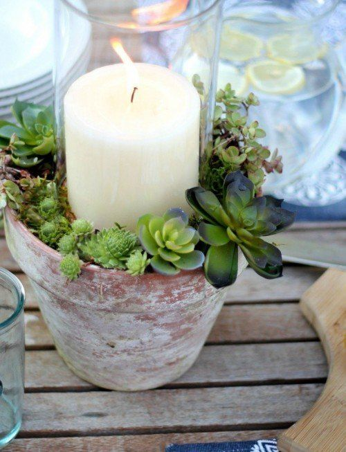 fill pot with dirt, add hurricane glass or jar in the middle, plant succulents around the jar - sweetest summer project ever!