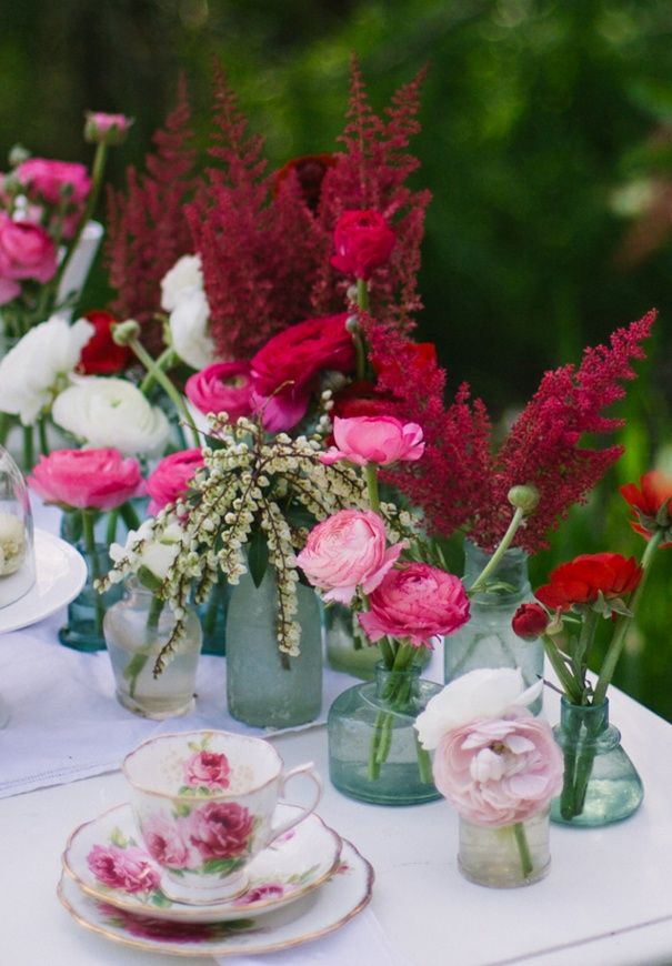 plum and blush toned flowers in vintage glass jars Photo by www.nicolecordeirophotography.com #flowers #vintage #glass #jar #styling #decoration #wedding #plum #pink #blush #roses #rose #wild #natural #rustic #bride #ceremony #reception #merlot