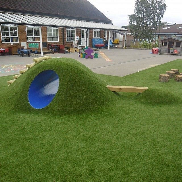 this eclipse tunnel mound is a fun addition to nursery playground equipment that is designed specifically