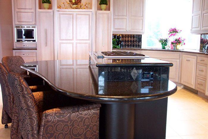 Bi level kitchen renovation black granite with copper for Bi level kitchen remodel ideas