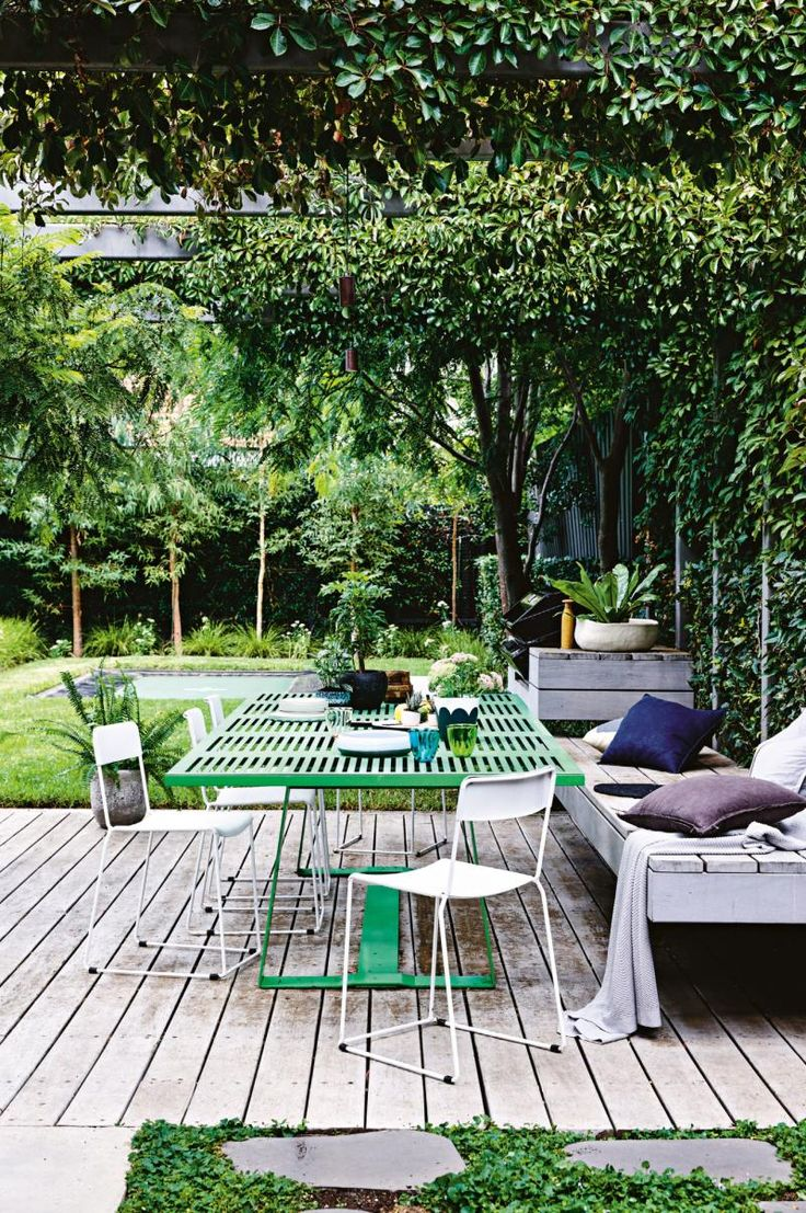 Terrace garden. Chalk white outdoor setting with Emerald Green