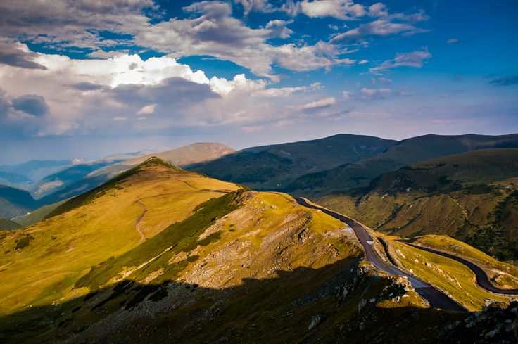 Golden sunset by Sporis Mihai Marian on 500px The highest mountain road in Romania, Transalpina Road. It reaches an altitude of almost 2150 m in Parang Mountains. This is the Muntinu Peak with the new Transalpina mountain road on it's ridge. www.romaniasfriends.com