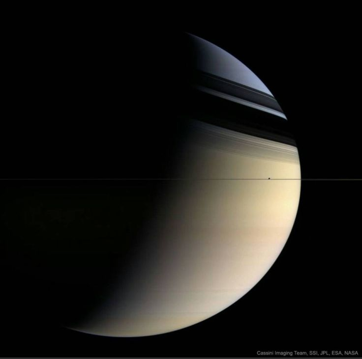 Why is Saturn partly blue? The featured picture of Saturn approximates what a human would see if hovering close to the giant ringed world. The image was taken in 2006 March by the robot Cassini spacecraft now orbiting Saturn. Here Saturn's majestic rings appear directly only as a thin vertical line. The rings show their complex structure in the dark shadows they create on the image left. Saturn's fountain moon Enceladus, only about 500 kilometers across, is seen as the bump in the plane of…