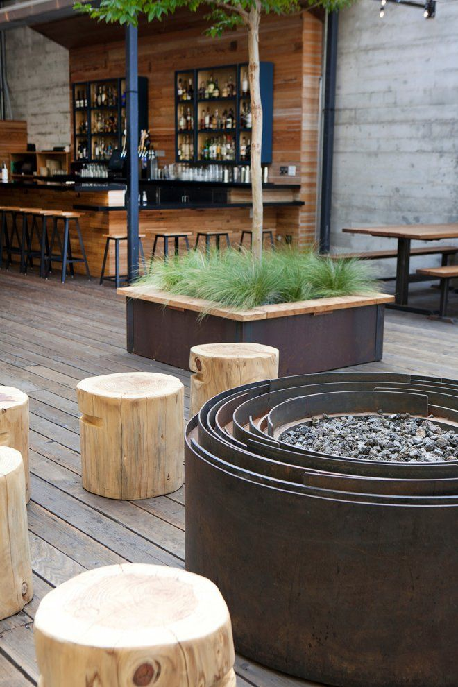 interesting steel firepit and tree stump chairs