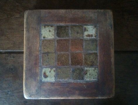 Antique French Tile and Wood Rustic Trivet Purchase in store here http://www.europeanvintageemporium.com/product/antique-french-tile-and-wood-rustic-trivet/