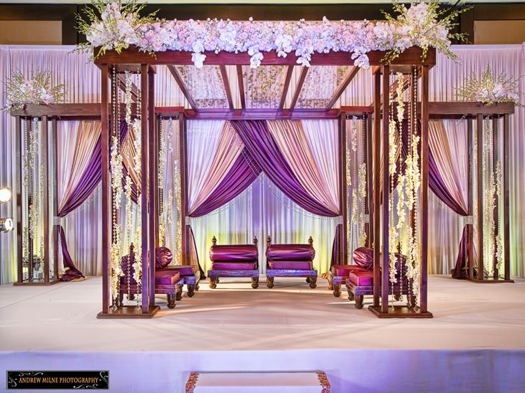 Wooden pillars + white flowers + violet curtains = A Breathtaking Mandap Decor! | Function Mania | #Trending: How to use hues of Ultraviolet for a chic wedding decor!