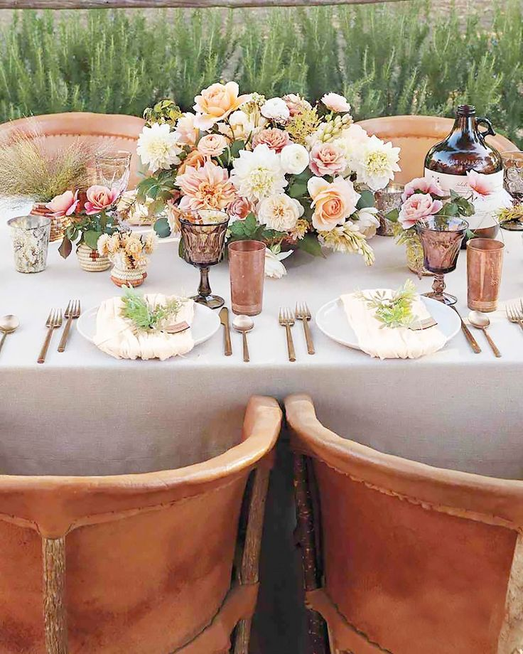 This picture-perfect setup stuck to a feminine color palette of pinks, peaches, and whites, which she accomplished with a host of flowers, including dahlias, tuberoses, acacia, and ranunculus. The addition of copper cups brings an edge to the feminine arrangements.