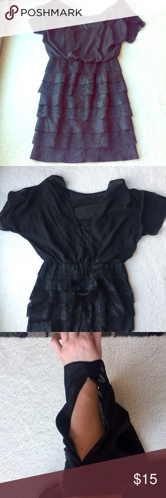Sexy Little Black Dress Sheer Black Overlay over Top Potion of Dress. Bottom is Tiered to about knee length. The sleeves have a sexy cut out on each shoulder showing the perfect amount of skin. This is a summer must have staple LBD. Size 14 from the Dress Barn but Tags removed Open to all offers. I am selling this for my mom and she just wants to have one sale. Dress Barn Dresses Midi