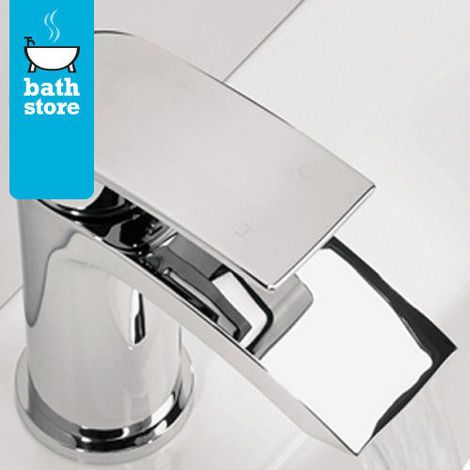 Flow basin mixer tap with flip top waste