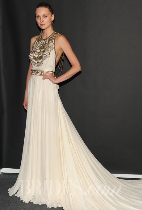 "Brides.com: Amanda Wakeley - Spring 2014. ""Cleopatra"" sleeveless silk A-line wedding dress with a beaded halter neckline and belt, Amanda Wakeley"