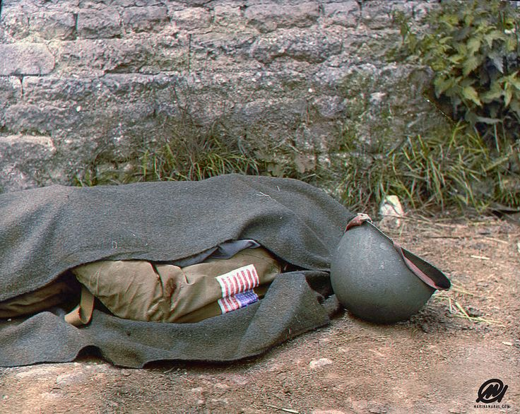https://flic.kr/p/A59xEv | Blanket covered body of a US paratrooper killed in action near Ste Mere-Eglise in the days following the Allied invasion of Normandy, aka D-Day. June 7, 1944.