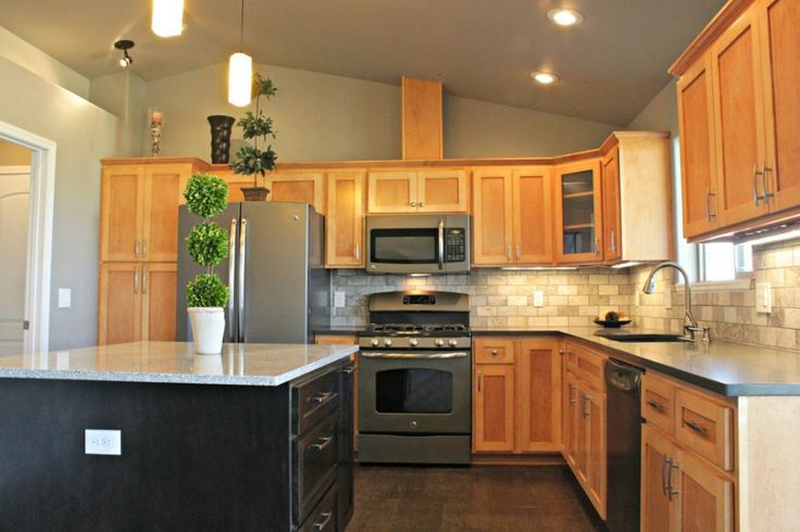 Nice Slate Appliances for Contemporary Kitchen Design: Refrigerator With Wood Cabinets And Brick Backsplash Plus Stove Also Slate Appliances With Potted Plants With Sloping Roof And Ceiling Lighting Plus Pendant Lighting And Wood Floor For Kitchen Design ~ franklester.com Home Design Inspiration
