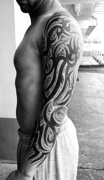black shadow tribal arm tattoos design