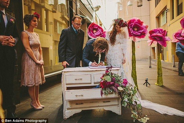 Signing the wedding book : Annie and Isaac in their pop up wedding...