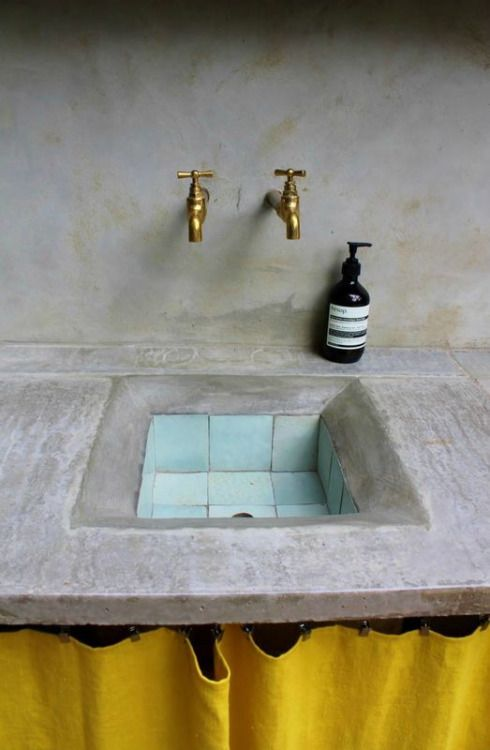 brass taps, quirky blue tiles and a pop of yellow