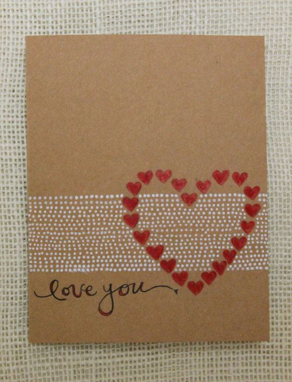 handmade Valentine card ...  clean and simple ... kraft ... one layer ... stamped in black, white and red ... heart stamp with hearts  around the edge (wreath?)