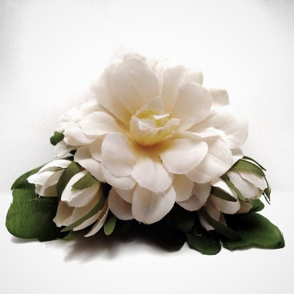 """Gardenia Hair Clip Pinup Rockabilly Bridal Champagne white with a touch of creamy yellow Gardenia pinup hair accessory. It would make a beautiful bridal clip.   4"""" x 3""""  Made with a clip barrette, so you can be active when wearing it (unlike the alligator clips) without worrying that your hair is out of place, or the clip falling out. Perfect for the rockabilly Betty riding in a convertible, or a burlesque dancer that needs to be able to move without a thing out if place. Fresh out of the…"""