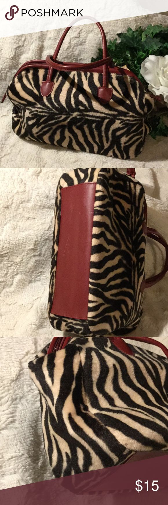 EUC Victoria Secret Faux Fur Animal Print Purse Excellent used condition. No rips, tears or stains. Inside is immaculate. Vegan dark red leather on bottom, handles & zippered opening. Chocolate brown & tan animal faux fur. 11'x 8'x4'. Victoria's Secret Bags Mini Bags