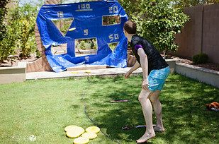 Slide and Toss | 27 Insanely Fun Outdoor Games You'll Want To Play All Summer Long