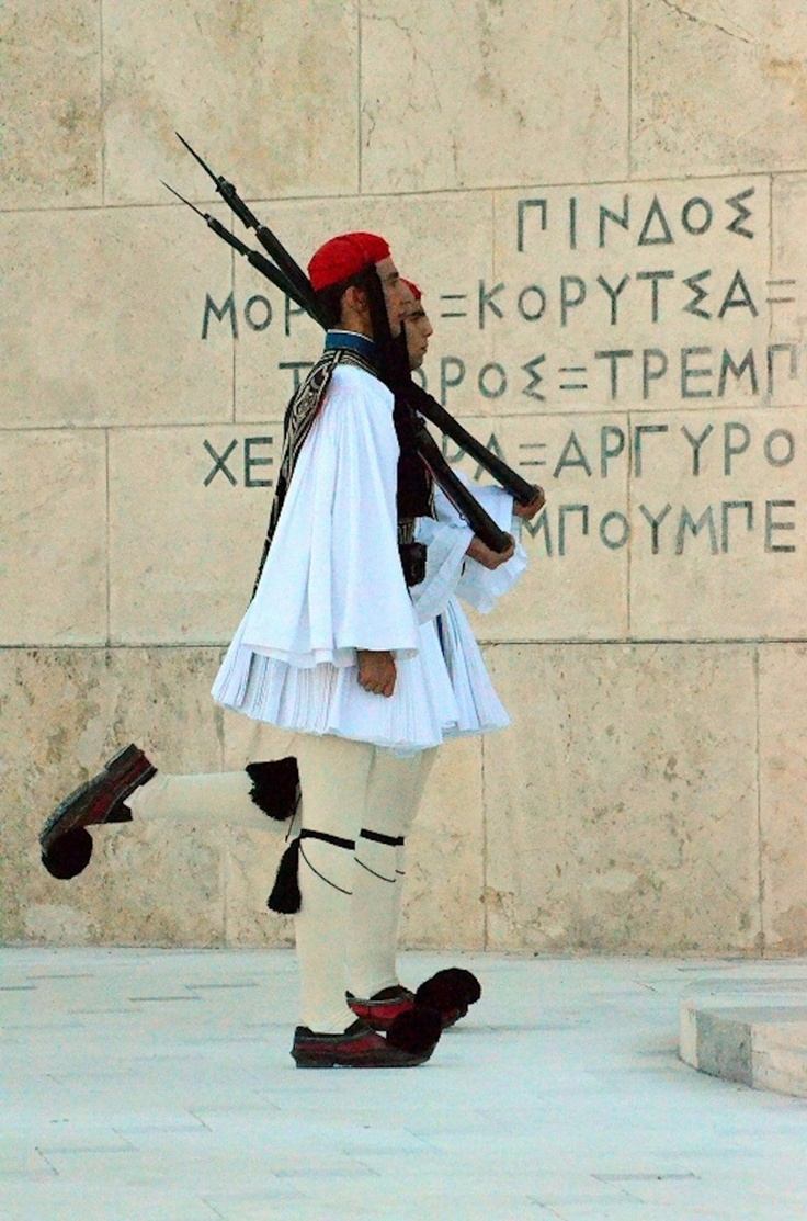 Changing of the Guard by Evzones , the Presidential elite ceremonial unit that guards the Greek Tomb of the Unknown Soldier