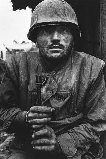 Don McCullin is one of the greatest war photographers. This is just one of many, many of his images. They are stunning.    http://www.guardian.co.uk/culture/2010/may/22/don-mccullin-southern-frontiers-interview    http://www.nytimes.com/1997/10/30/style/30iht-don.t.html?pagewanted=all