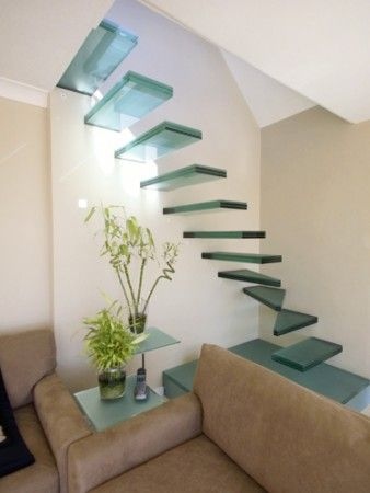 Floating Stairs, I wonder how they did this ??? that looks like some kind of see through material