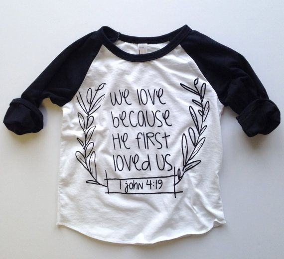 He first loved us . Baseball tee by greythread on Etsy, $18.00