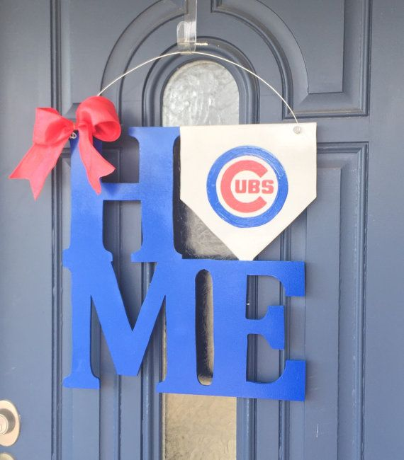 "Custom HOME door hanger. Hand cut & hand painted.These measure roughly 18.5""x18"" and 1/4"" thick. They include a wire hanger and bow.  I use official Cubs color matched paint (Although the the lighting in the picture makes the colors look different).   These are made to order and will ship 1-2 weeks from the time payment is made.  No refunds due to the custom nature of the product. However, I want YOU to be happy with your purchase and will do everything (within reason) to resolve an..."