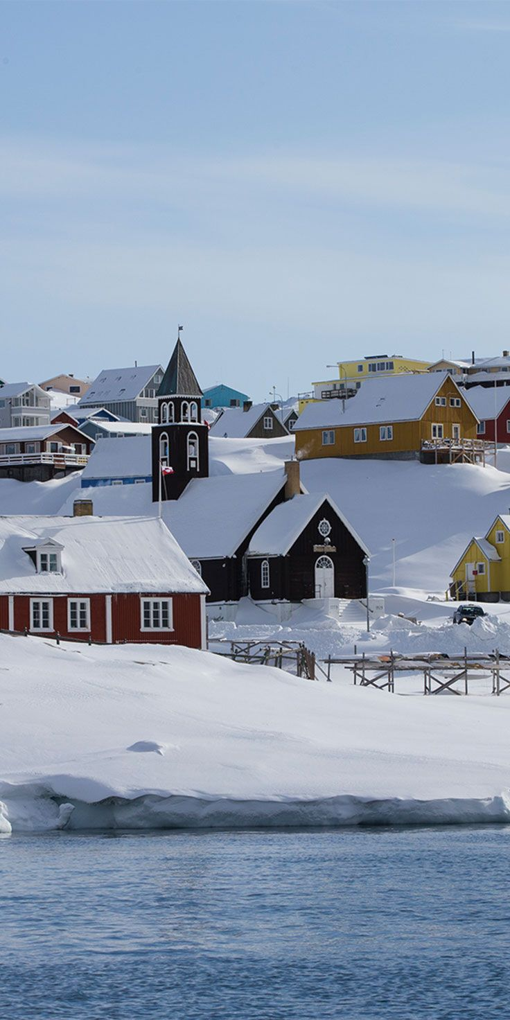 Snow-capped homes in Greenland - by Sean Scott