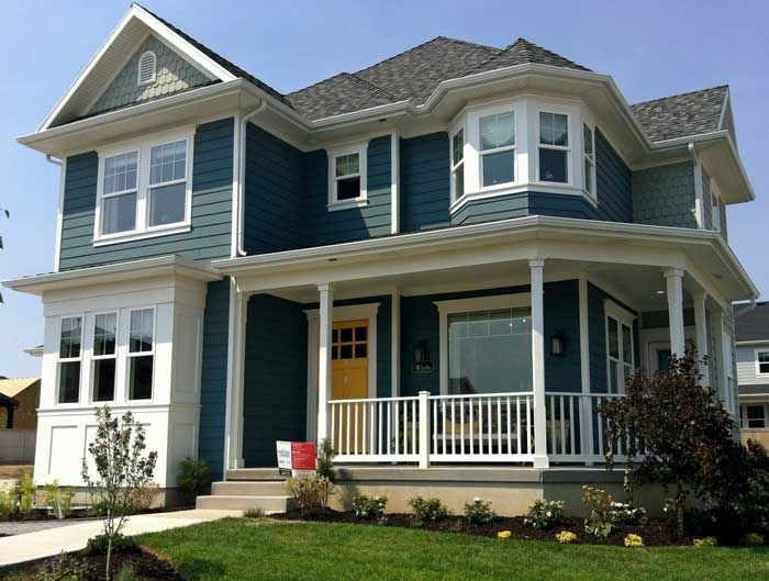 "The paint is by Sherwin Williams.  The blue color is ""Riverway"".  The yellow front door is ""Butterfield""."
