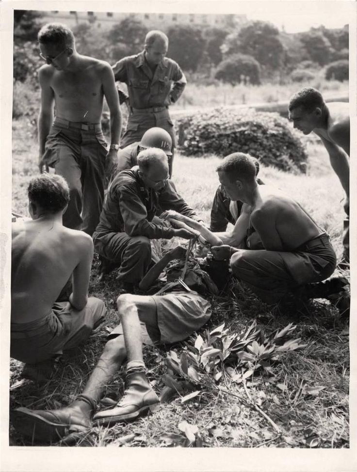1945- Dutch prisoner of war gets first aid from U.S. soldier after airborne troops dropped on Yokohama, Japan.